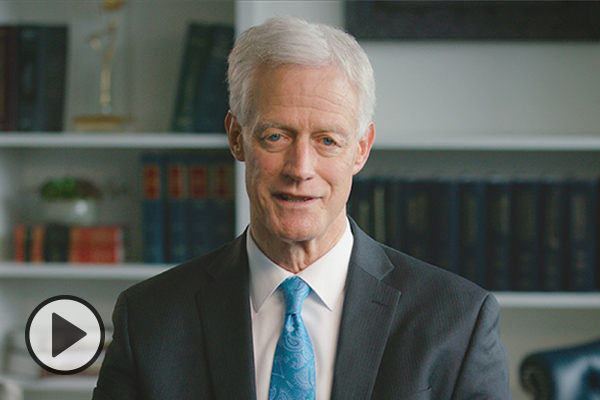 Screen grab of President Worthen with video icon.