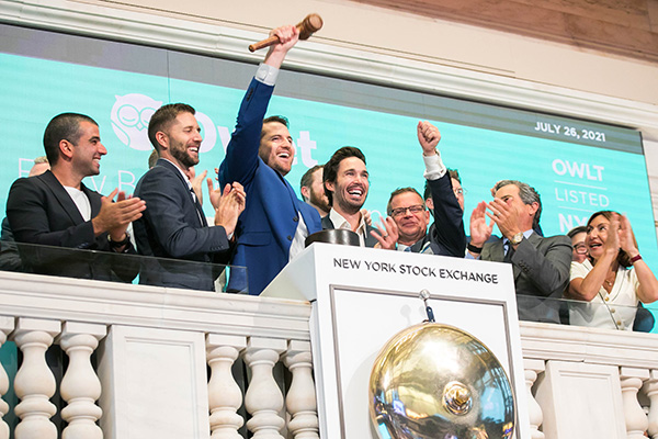 Kurt Workman and the Owlet Baby Care team celebrates above the NYSE bell.