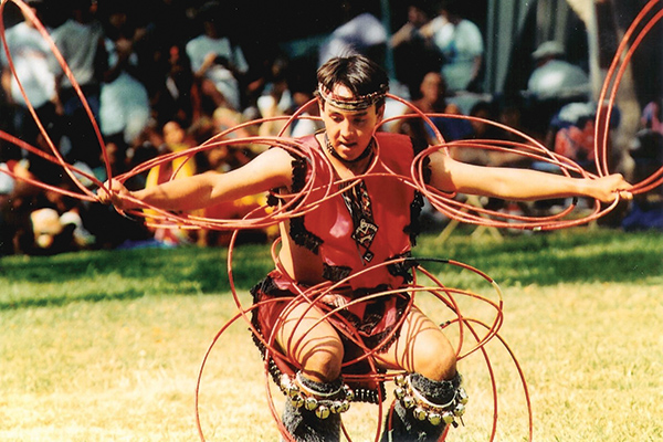 Joseph Ahuna performs a Native American hoop dance at a multicultural festival in Hawaii.