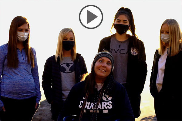 Five young female BYU students gather before ascending Y Mountain.