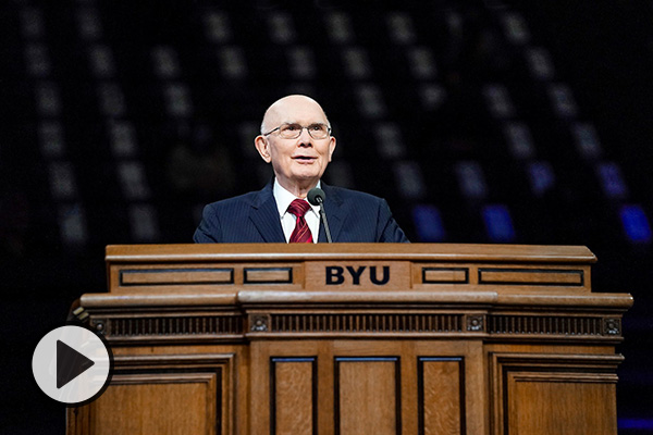 President Dallin H. Oaks stands at the podium of the BYU Marriott Center.