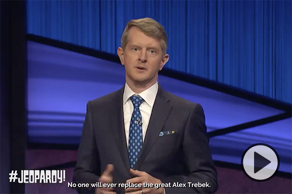 Jeopardy! guest host and BYU grad Ken Jennings stands on the set of the trivia show. The words No one will ever replace the great Alex Trebek appear below.