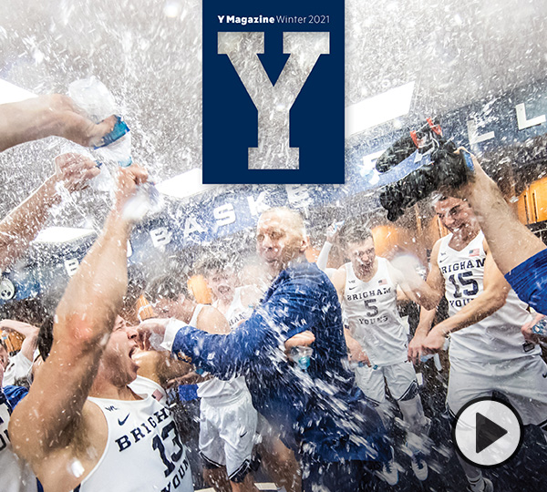 Mark Pope and the 2020 BYU basketball team celebrate with water bottles in the locker room after a big win.
