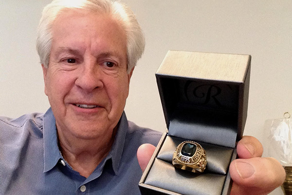 BYU grad Eric Paul shows off the recently returned class ring he had lost some 50 years ago.
