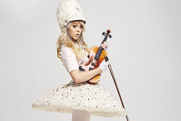 Lindsey Stirling, pictured in a white custom costume is arguably the best-known violinist in the world. Photo by Cara Robbins.