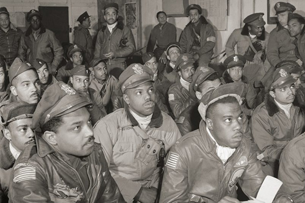 The Tuskegee Airmen were among the more than 16 million Americans who served in the US Armed Forces during WWII. A BYU alum has a goal to tell the story of all 405,399 servicemen and women who perished in the struggle. Photo by Toni Frissell/Library of Congress.