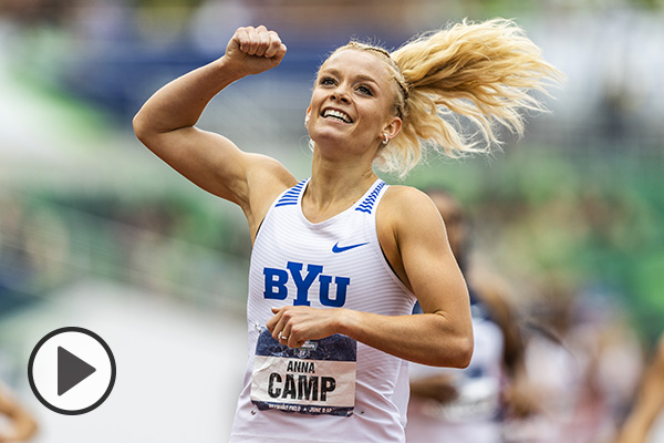 1500m champ Anna Camp-Bennett pumps her fist in teh air after crossing the finish line.