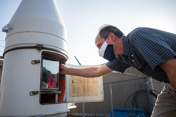 BYU geography professor Matt Bekker checks a weather station.