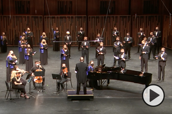 The BYU Singers and some stringed instrumentalists perform in the de Jong Concert Hall of the Harris Fine Arts Center.