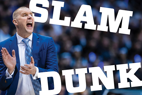 Head coach Mark Pope in a blue suit and blue tie yells and claps during a game. The words Slam Dunk appear at right.