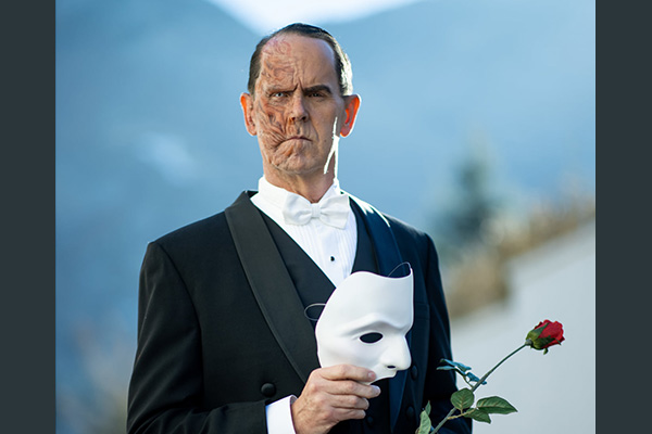 BYU athletic director Tom Holmoe dressed up as the Phantom of the Opera.