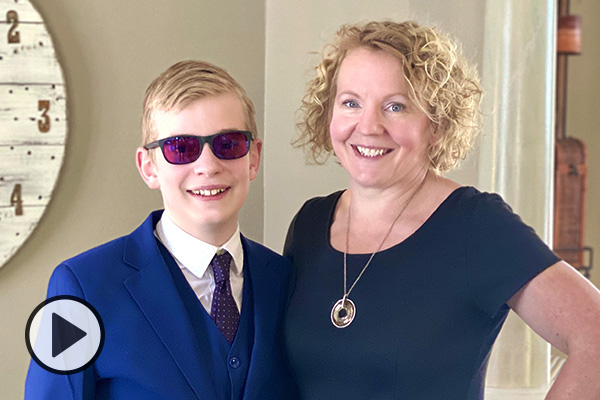 Carole Jones and her son Jonathan who is wearing Enchroma glasses.