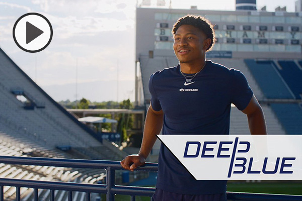 Malik Moore leans on a railing at Lavell Edwards Stadium. The words Deep Blue are at bottom right.