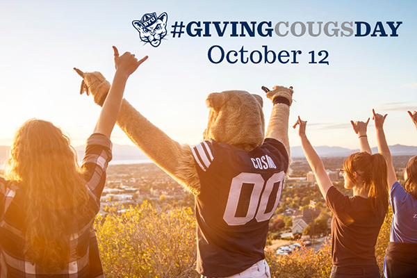 Giving Cougsday Oct. 12. Cosmo and some BYU students raise double shaka hands as they look over Utah Valley.