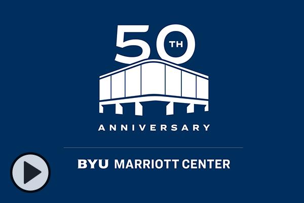 A white on blue 50th anniversary BYU Marriott Center logo.
