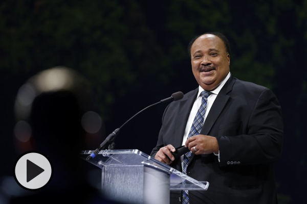 Martin Luther King III smiles as he speaks at a BYU forum in the Marriott Center.