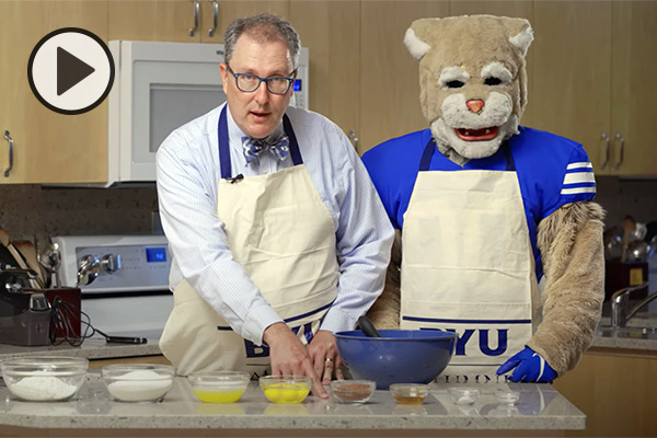 Curtis and Cosmo are in the kitchen, showing all the ingredients for mixing up a batch of BYU mint brownies.