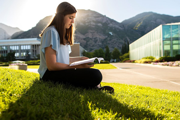A BYU student studies as the sun comes up on campus. Photo by BYU Photo.